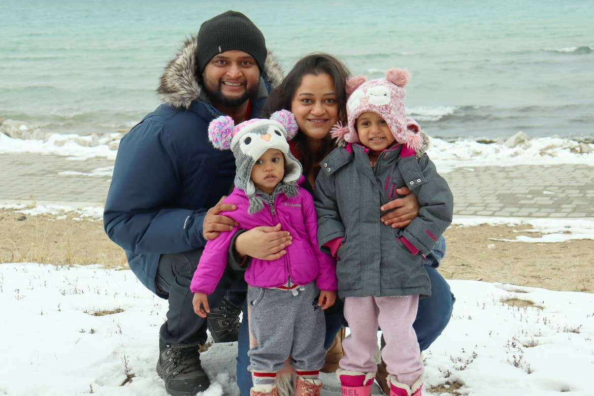 Featured Contributor, Karishma Kittur (right), her husband, Rohan (left) and two daughters, Myrra (front-left) and Amarra (front-right).