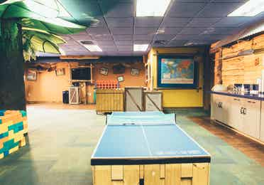 Activities room with ping pong table, life-sized Connect 4, and flat screen TV in West Village at Orange Lake Resort near Orlando, Florida