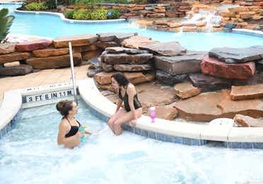 Family relaxing in hot tub at Orange Lake Resort near Orlando, Florida