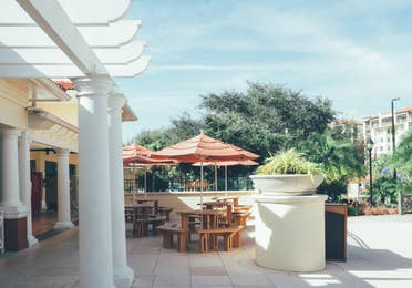 Outdoor seating under umbrellas in River Island at Orange Lake Resort near Orlando, Florida