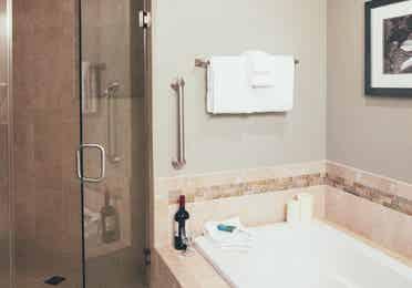 Soaking bathtub and walk-in shower in a two bedroom villa in West Village at Orange Lake Resort near Orlando, FL