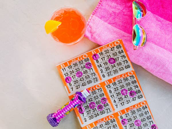 Bingo card with marker, sunglasses and drink.