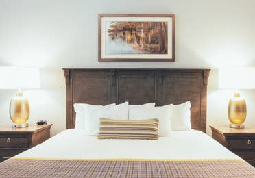 Bed with two nightstands in a villa in River Island at Orange Lake Resort near Orlando, Florida
