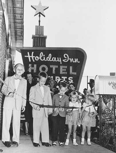 The Wilson family cutting a ribbon at a Holiday Inn