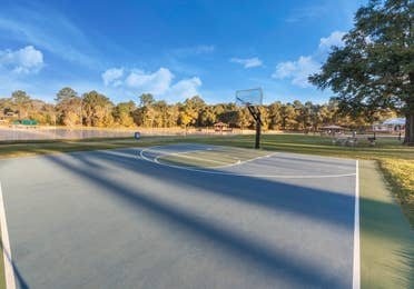 Outdoor basketball court at Piney Shores Resort in Conroe, Texas