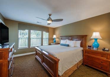 Large bedroom in a two-bedroom ambassador villa at the Holiday Hills Resort in Branson Missouri.