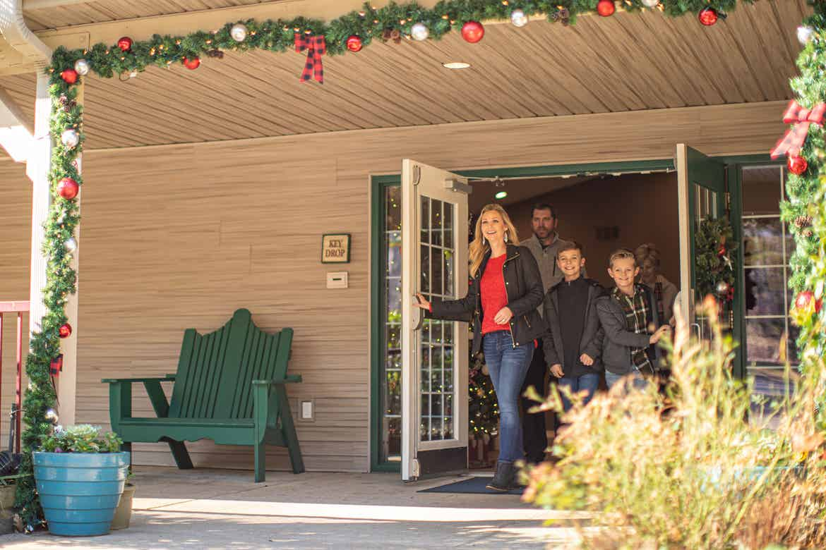 Author, Amanda Nall (left), walks out of the doors of our Villages Resort lobby with her family.