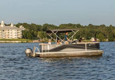 Family riding on pontoon boat at Villages Resort in Flint, Texas.