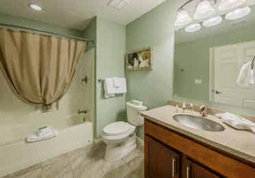 Bathroom with shower tub in a one-bedroom ambassador villa at the Hill Country Resort in Canyon Lake, Texas.