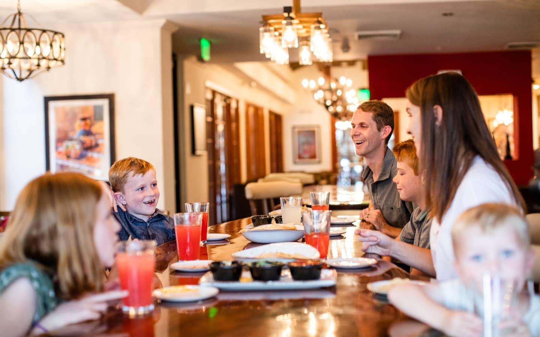 Family eating at ArteZania Kitchen & Cantina at Scottsdale Resort.