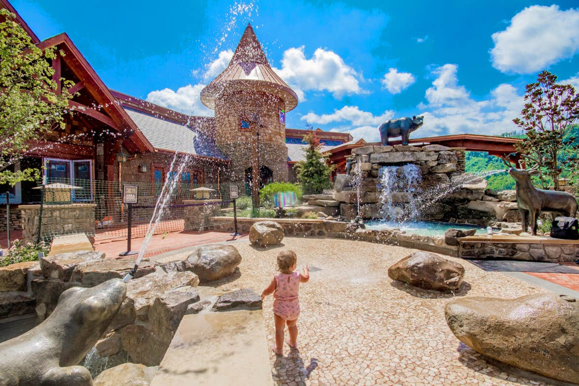 A toddler faces the splash pad at Anakeesta Theme Park.