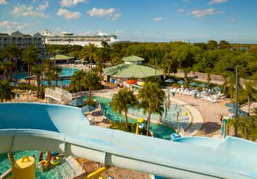 View from a water-slide overlooking a resort pool and Port Canaveral at Cape Canaveral Beach Resort