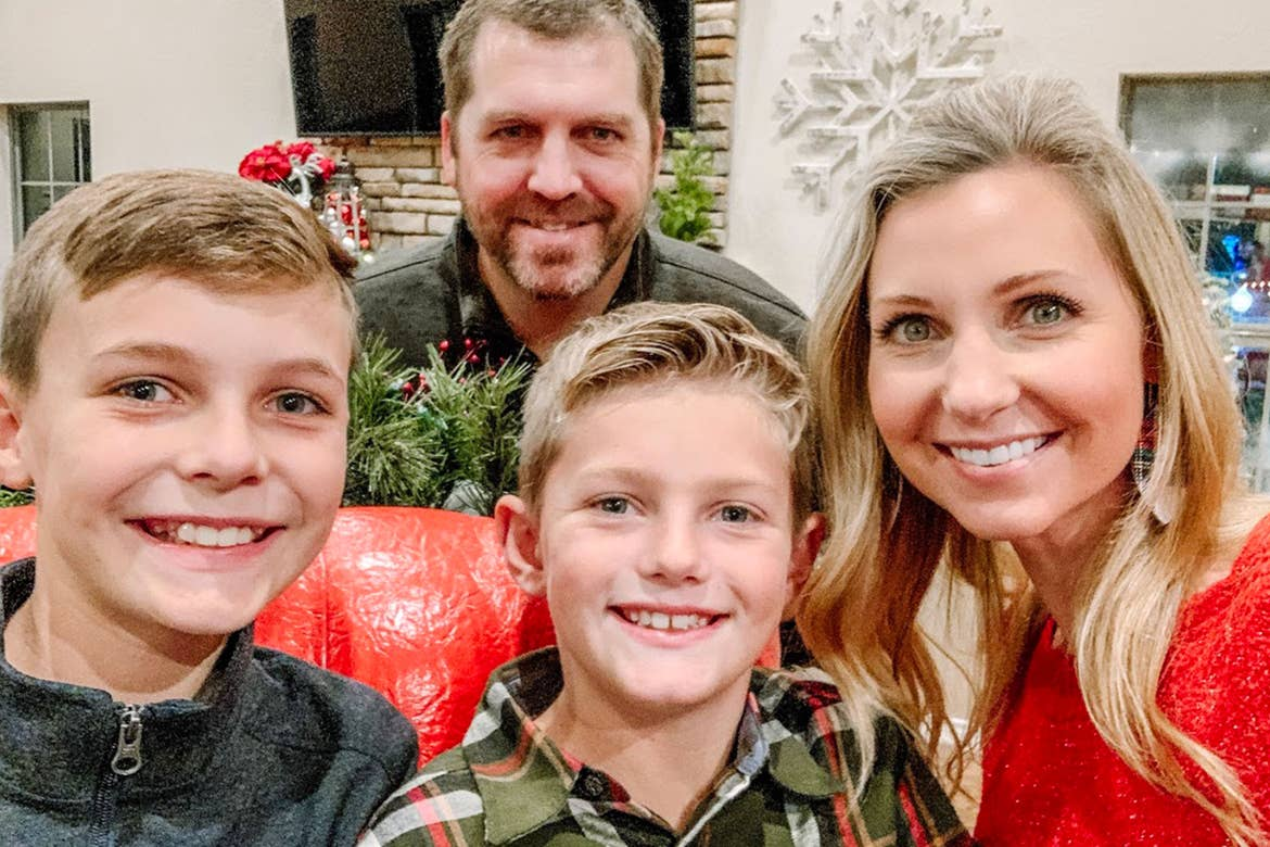 Author, Amanda Nall (right), and her family pose for a photo surrounded by holiday decor.