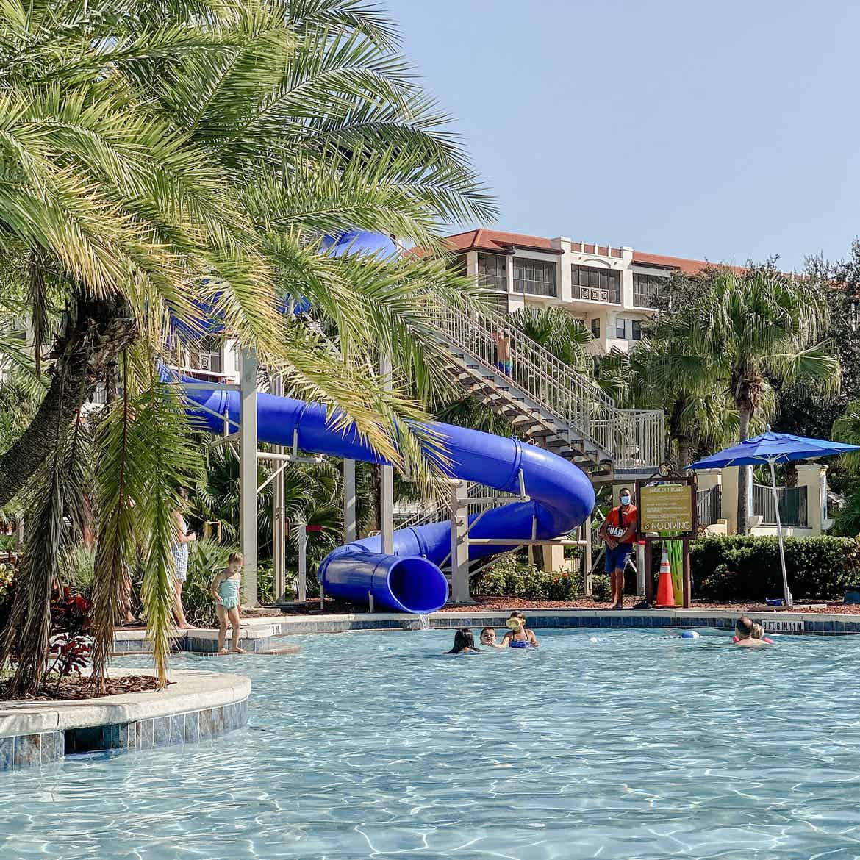Guests enjoy a swim in our pool at Orange Lake Resort in Florida.