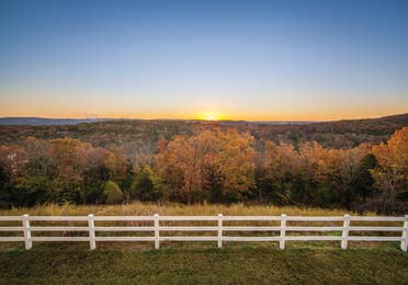 Nature trail with view of fall foliage at Ozark Mountain Resort in Kimberling City, Missouri.