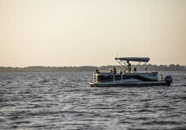 Pontoon boat on Lake Palestine near Villages Resort in Flint, Texas.