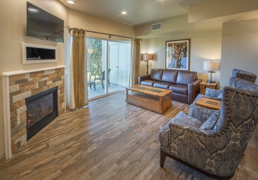 Living room area with fireplace in an upgraded one-bedroom villa at David Walley's Resort in Genoa, Nevada