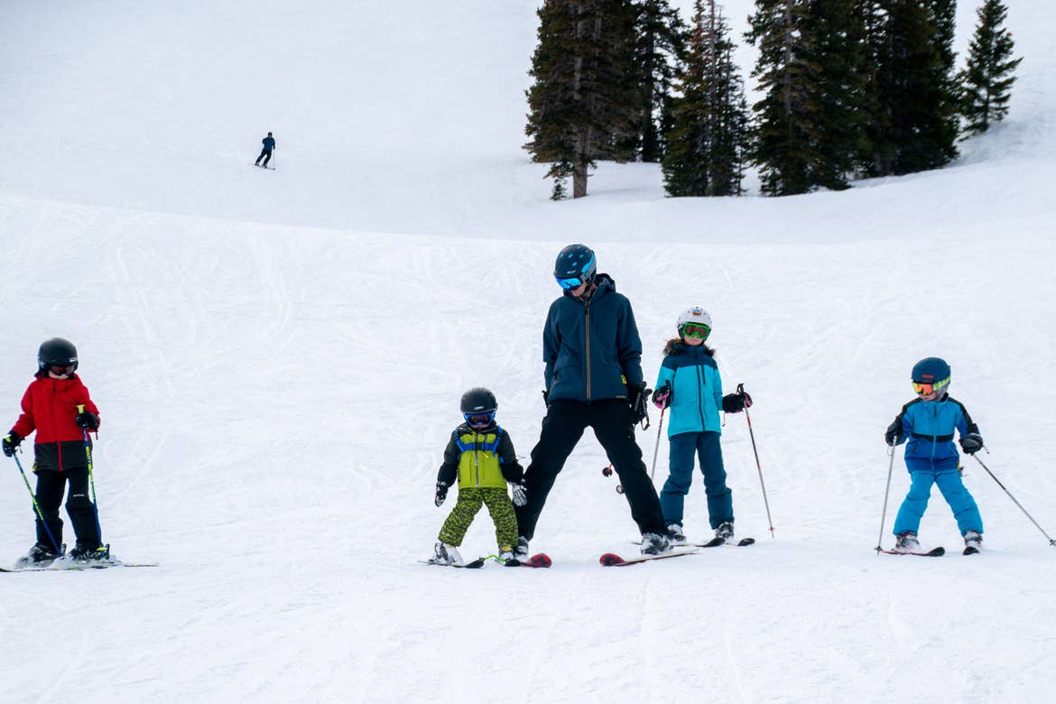 Jessica's family, adorn with ski gear, make their way down the snowy slopes.