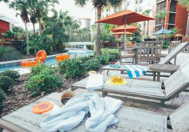 Sun chairs by lazy river in River Island at Orange Lake Resort near Orlando, Florida