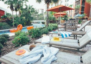 Sun chairs by lazy river in River Island at Orange Lake Resort near Orlando, Florida
