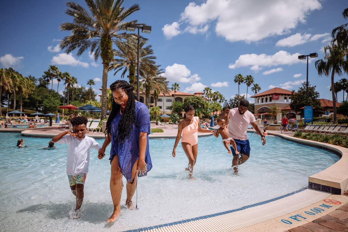 The Godfrey family emerges from our zero-entry pool in swimwear in River Island at our Orange Lake resort located in Orlando, FL.