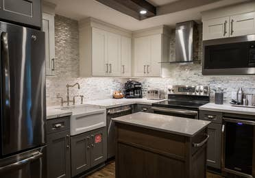 Full kitchen with stainless steel appliances in a two-bedroom Signature Collection villa at Cape Canaveral Beach Resort.