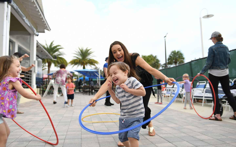 Children hula-hooping at Orange Lake Resort near Orlando, Florida.