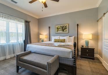 Bedroom in a Signature Collection villa at Williamsburg Resort.