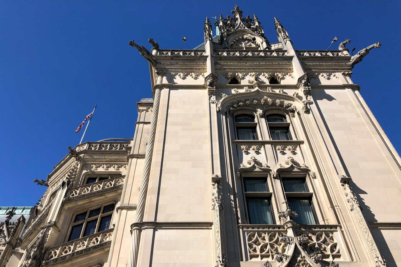The exterior of the Biltmore Estate under a blue sky.