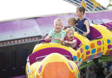 Children enjoying a kiddie ride