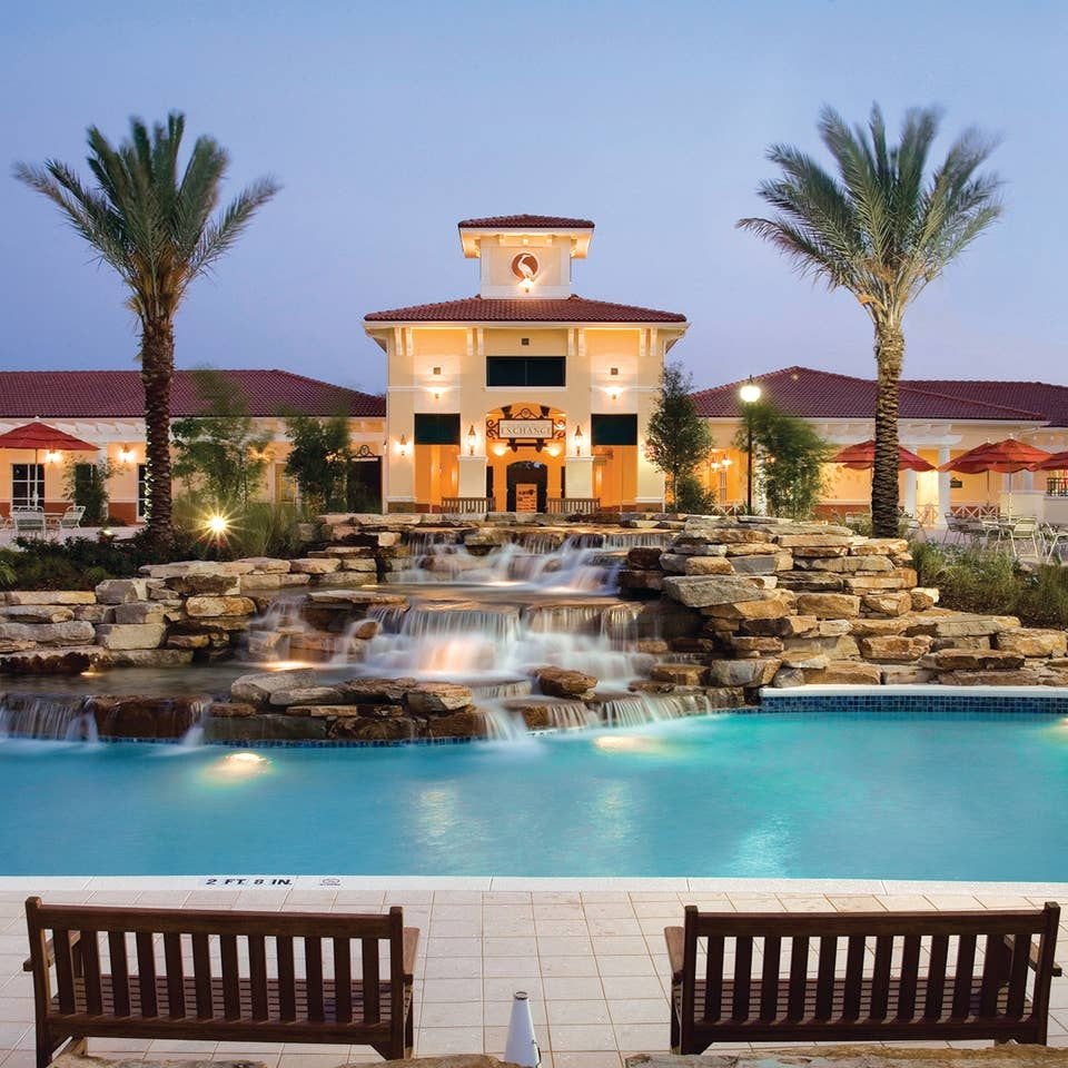 View of lazy river and The Exchange at night in River Island at Orange Lake Resort near Orlando, Florida