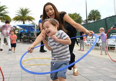 Children hula-hooping at Orange Lake Resort near Orlando, Florida.