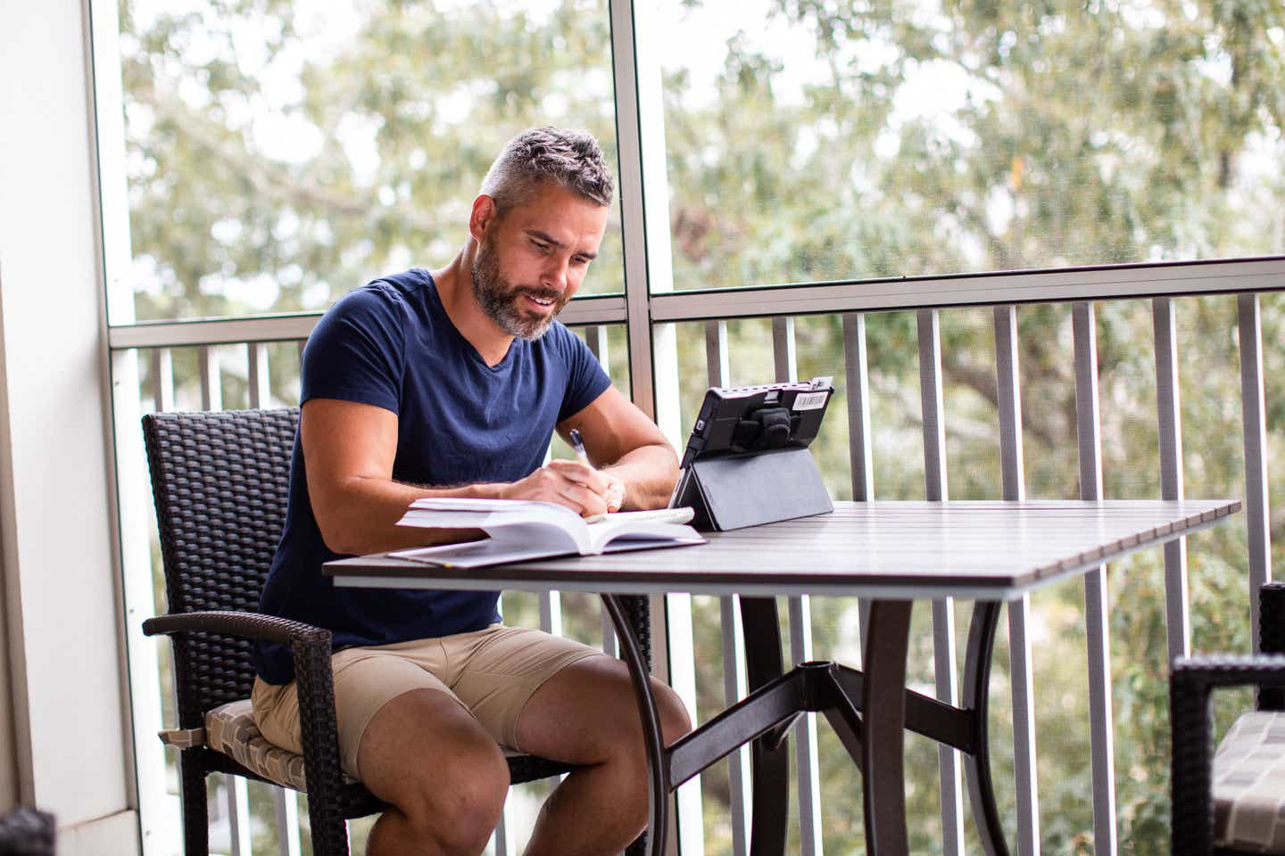 Brenda Rivera Sterns' husband, Isaiah, works remotely on the patio of our Signature Collection villa at our South Beach Resort in Myrtle Beach, South Carolina.