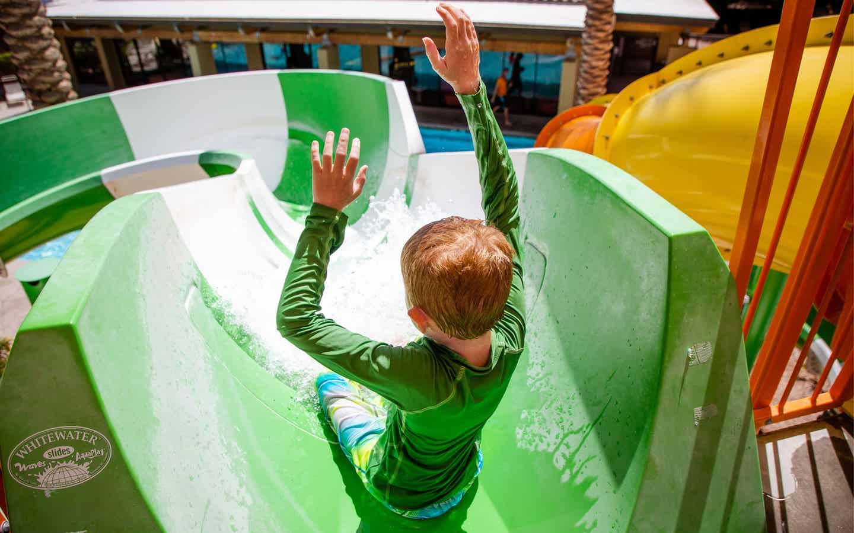 Child going down waterslide in Splash Canyon at Scottsdale Resort.