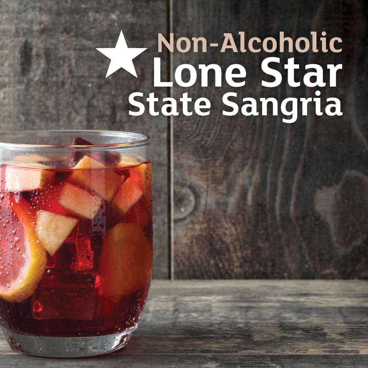 A glass of sangria set on a wooden plank table. Type on the left says, 'Non-Alcoholic Lone Star State Sangria.'