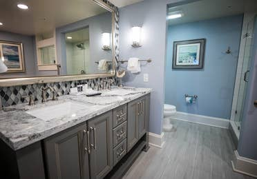 Bathroom with double vanity in a two-bedroom Signature Collection villa at Cape Canaveral Beach Resort.