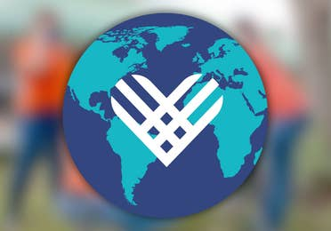 Giving Tuesday Globe logo on top of a blurred image.
