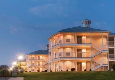 Villa lite up at night at the Holiday Hills Resort in Branson Missouri.