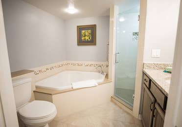 Bathroom with tub and walk-in shower in a villa at Cape Canaveral Beach Resort.