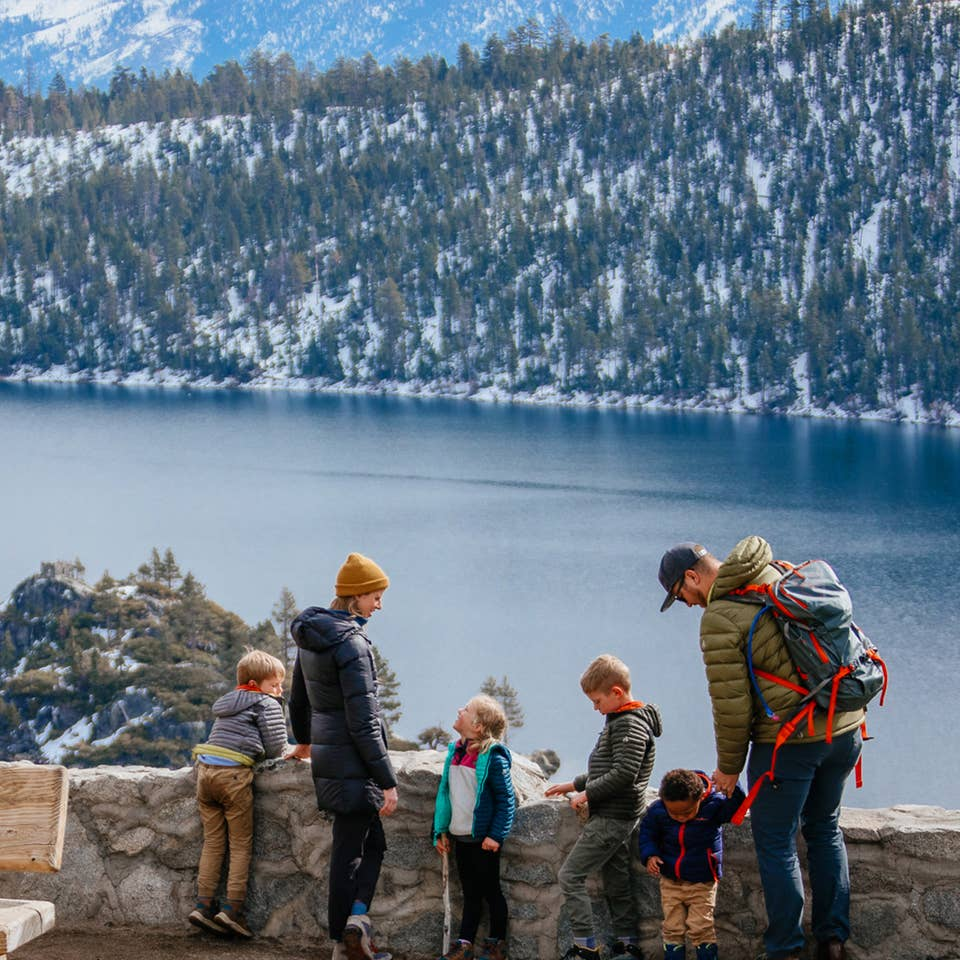 Andrea Rassmussen's family stands overlooking Emerald Bay State Park with a gorgeous forest, mountains and lake as a backdrop.