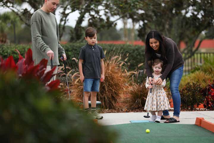 Family playing mini golf at Orange Lake Resort near Orlando, Florida