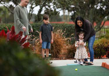 Family playing mini golf at Orange Lake Resort near Orlando, Florida