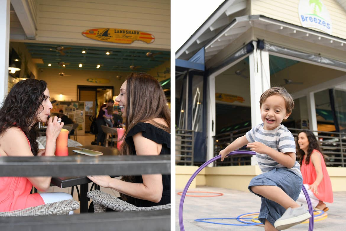 Left: Two women seated on an outdoor patio of the Breezes Restaurant and Bar in West Village at Orange Lake Resort in Orlando, FL. Right: A young boy hula hoops as his mother looks onward in front of the Breezes Restaurant and Bar in West Village.