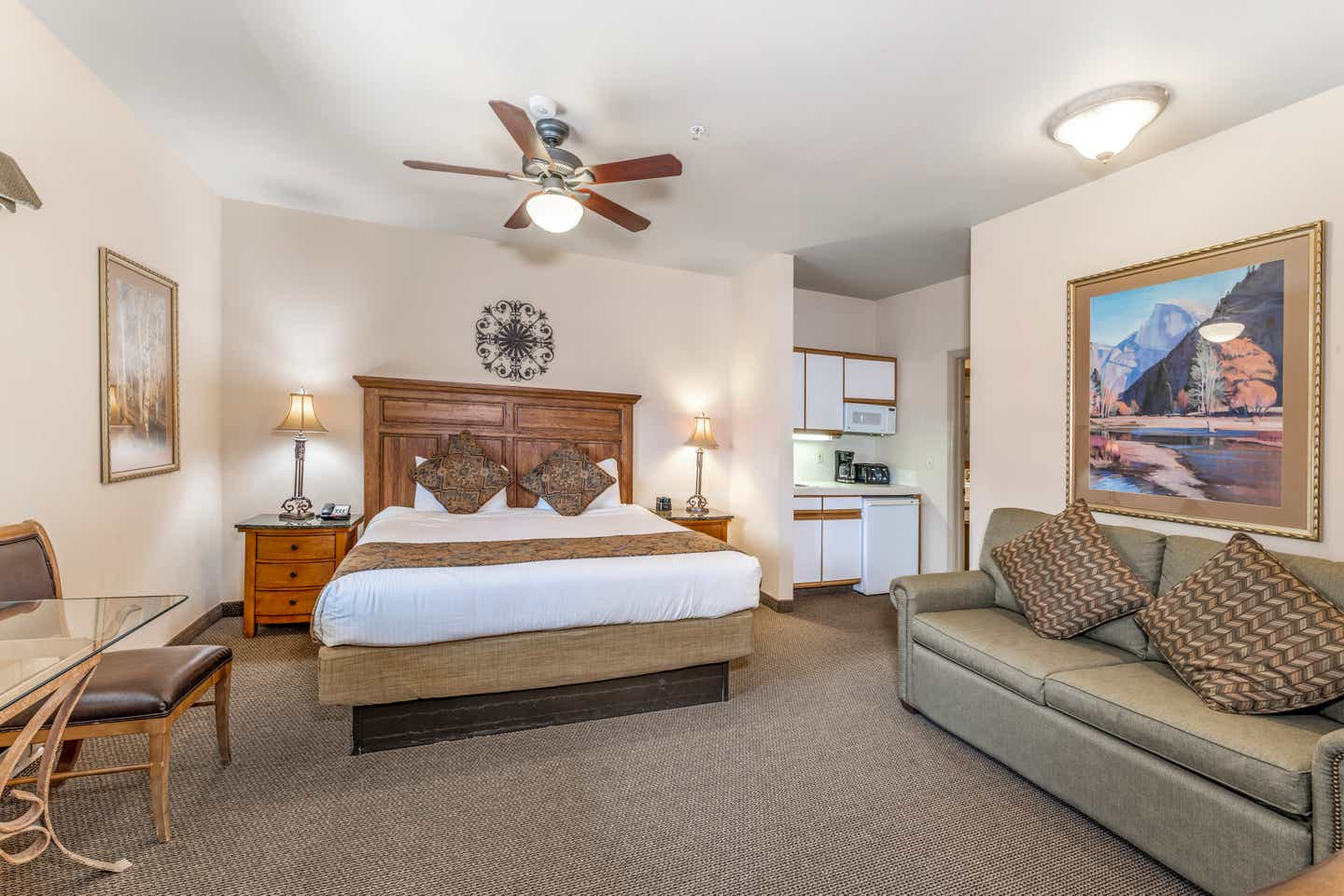 Bed and living area in a Ridge Pointe studio villa at Tahoe Ridge Resort