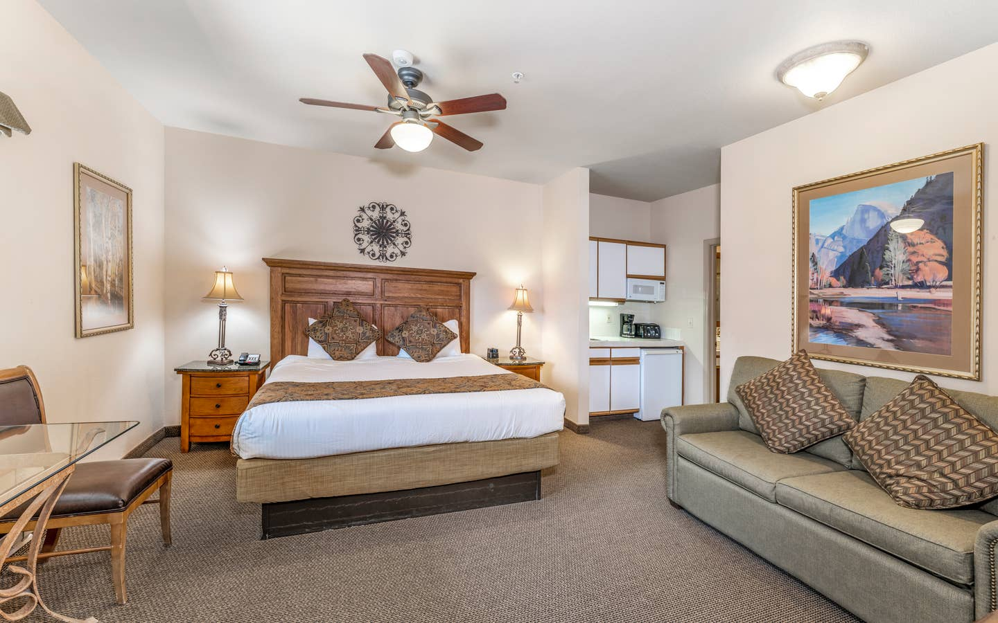 Bed and living area in a Ridge Pointe villa at Tahoe Ridge Resort