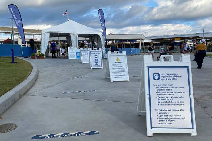 Magic Kingdom Transportation center entrance with safety instructions for guests to follow upon park arrival.