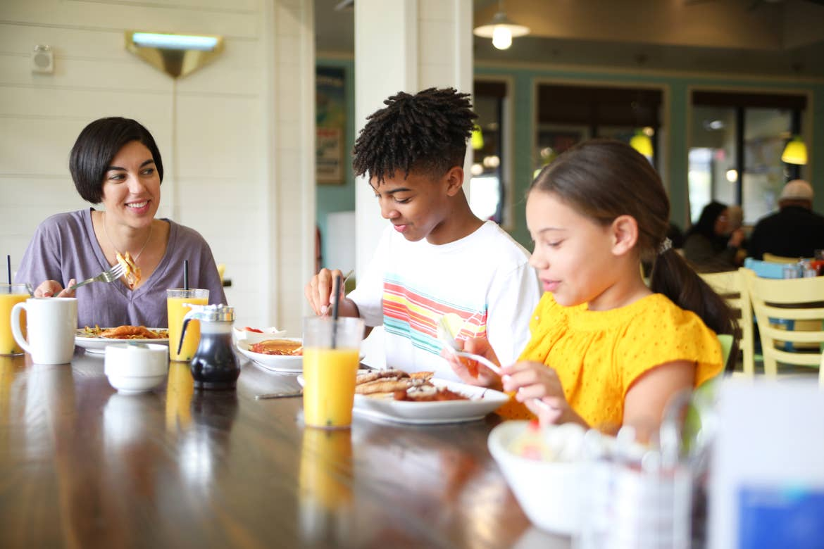 Featured Contributor, Clarissa Laskey (left) and her children enjoy some beverages at a table at Breezes at our Orange Lake resort located near Orlando, FL.