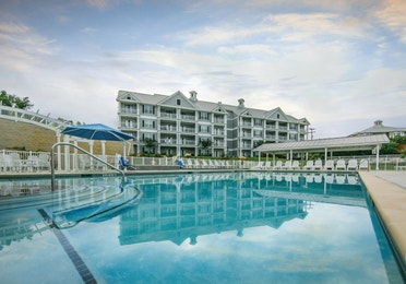Outdoor pool and sun chairs at Hill Country Resort in Canyon Lake, Texas