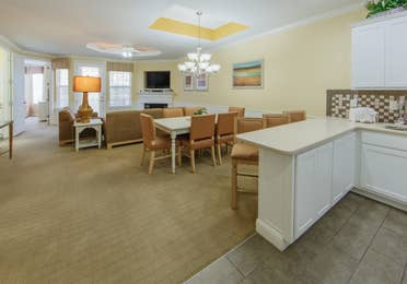 Dining area and living room in a two-bedroom presidential villa at Apple Mountain Resort in Clarkesville, GA