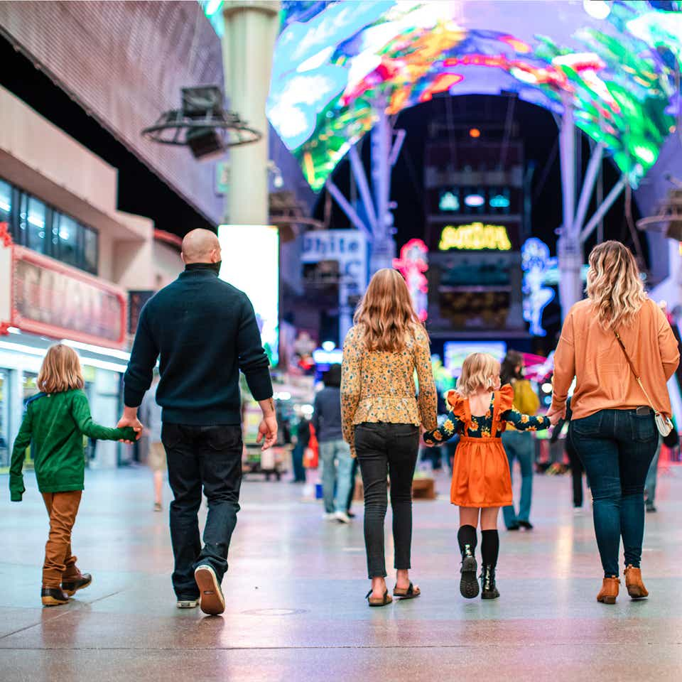 The Haby family walk down Fremont street near our Desert Club Resort located in Las Vegas, Nevada.